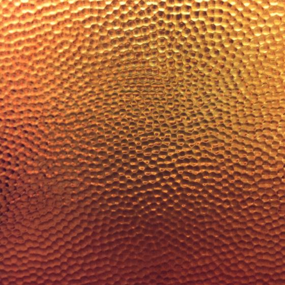 hammered copper backsplash. http://www.frigodesign/custom