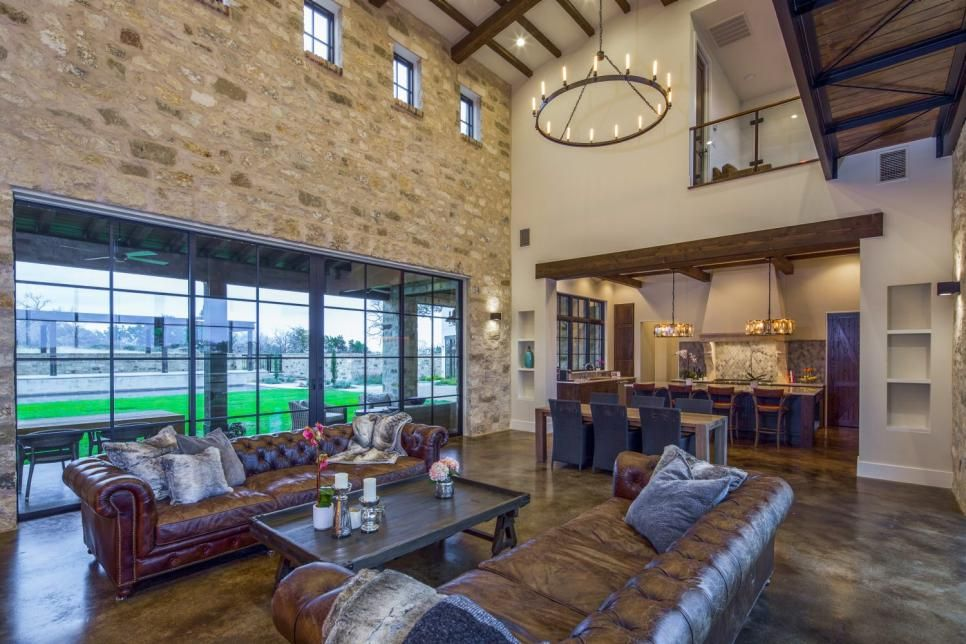 Massive windows bring loads of light into this austin custom home which blends traditional italian