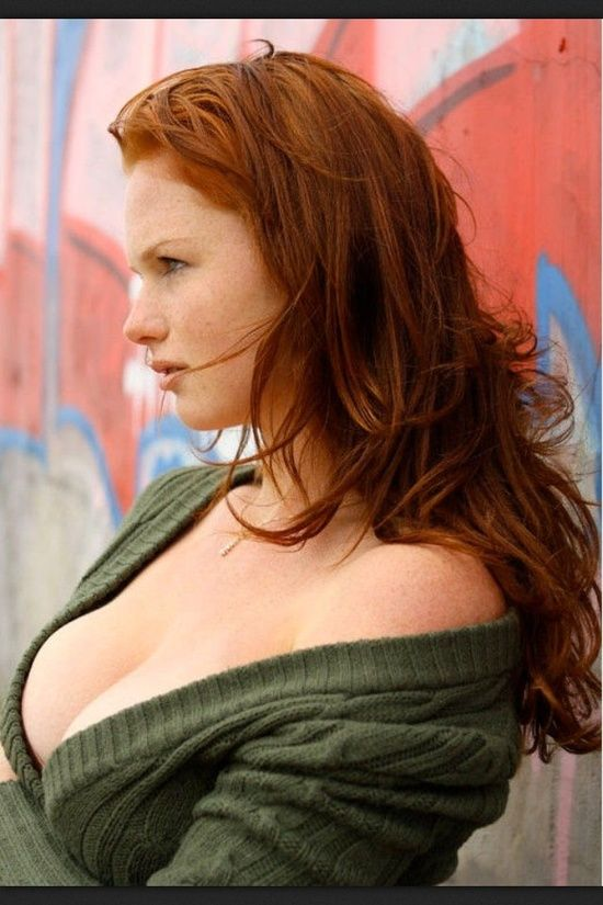 Sexy beautiful redhead girl with long hair. perfect woman