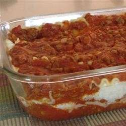 Lasagna with cottage cheese and homemade beefy tomato sauce.