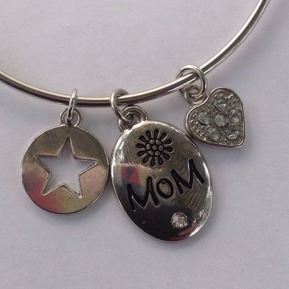 Mom Charm Bracelet You can add charms to this bracelet. I started you off with 3 charms. Star , heart with white crystals, and mom charm. Silver tone it is nickel free. New! Jewelry Bracelets