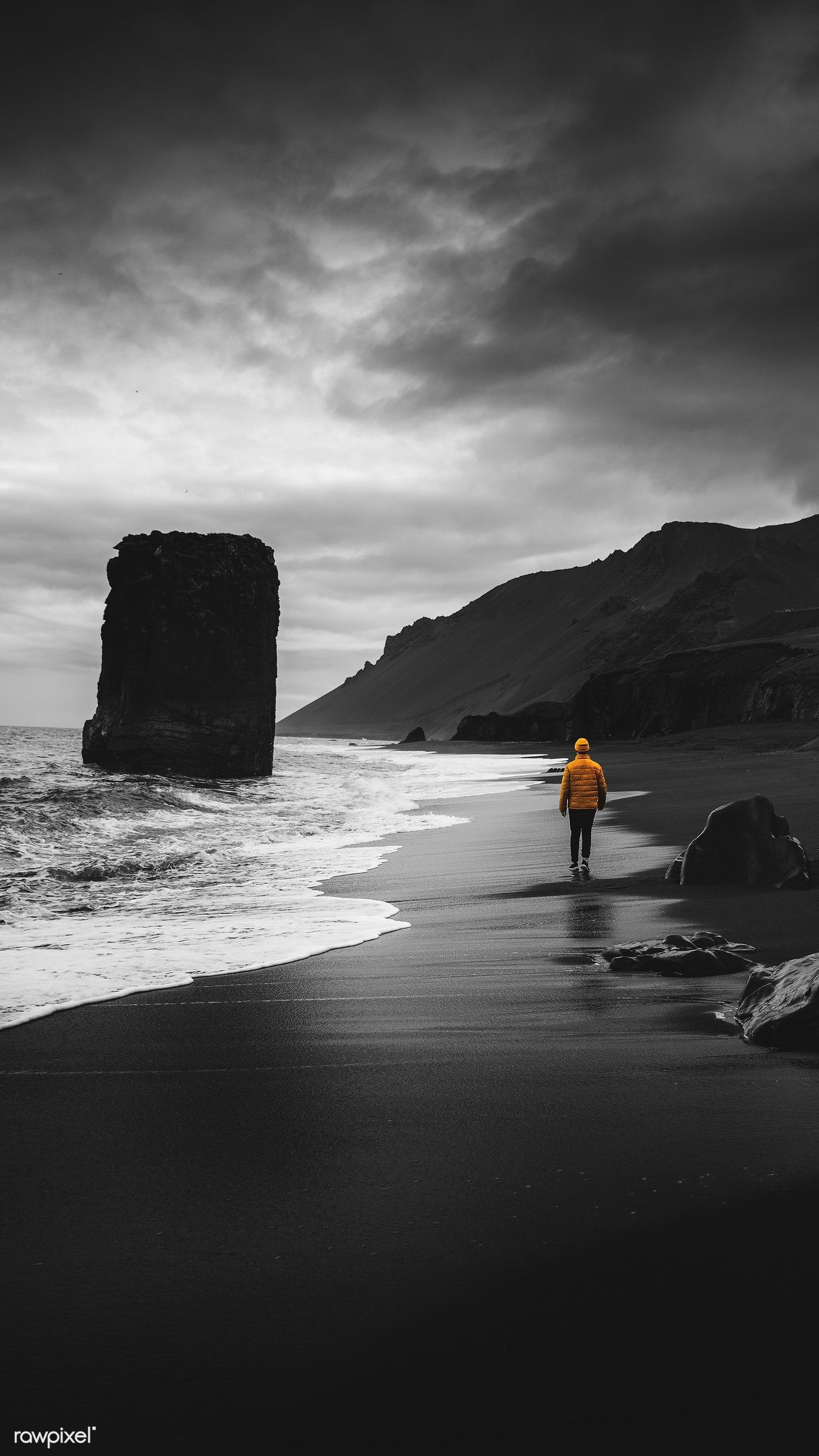 Download Premium Image Of Man Walking Along A Black Beach In Iceland Beach Phone Wallpaper Beautiful Wallpapers Backgrounds Iceland Wallpaper