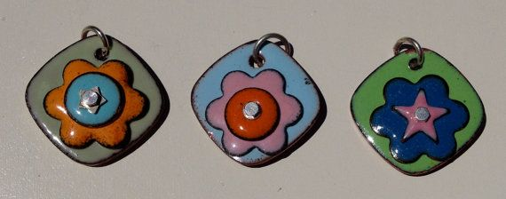Handmade in the USA copper enamel pendant necklaces. Colored flower necklaces on a diamond pendant and sterling silver chain