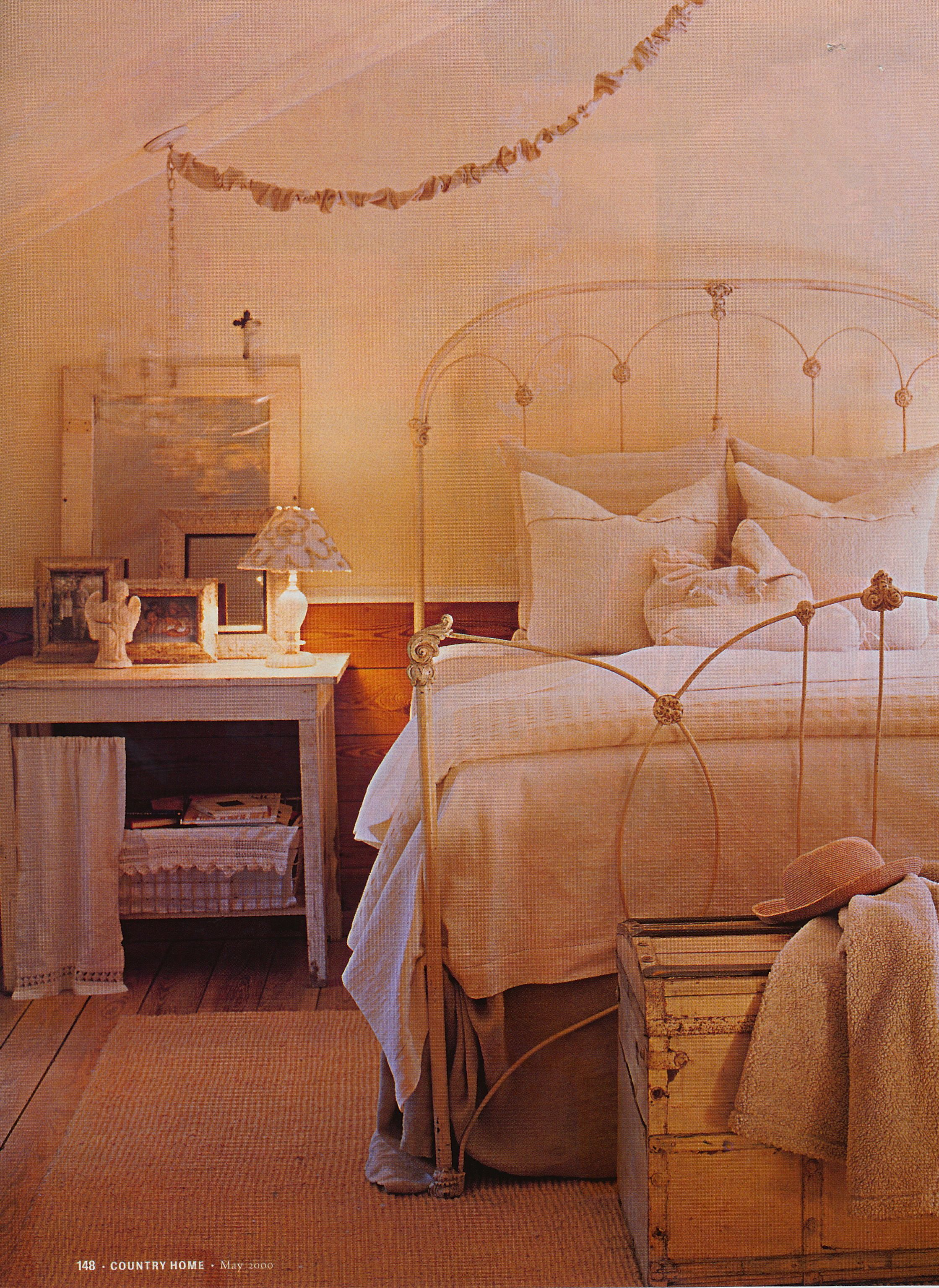 Country Home May 2000. Cozy bedroom in cream colors with