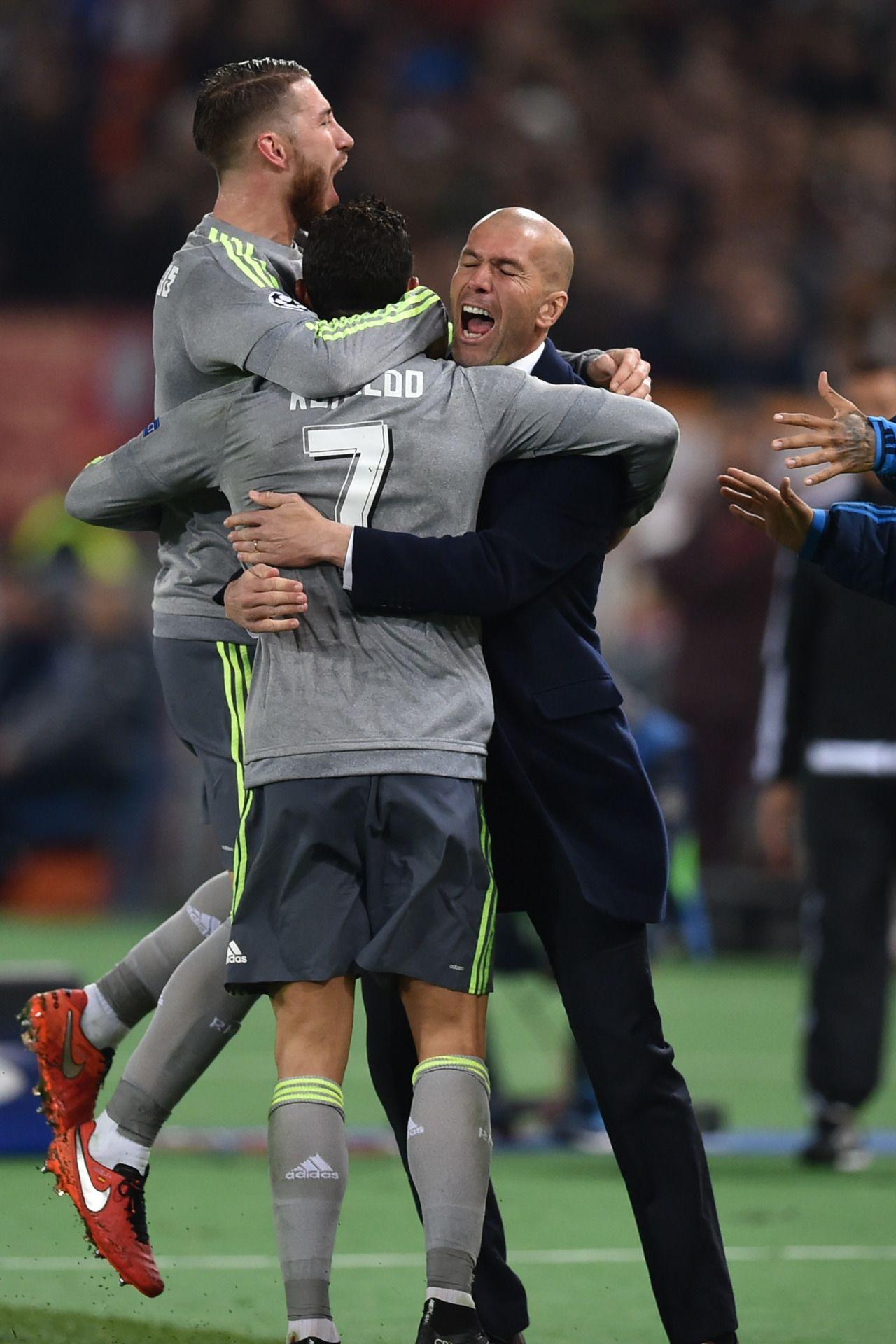 Ramos, Ronaldo, and Zidane celebrate Cristiano's goal.