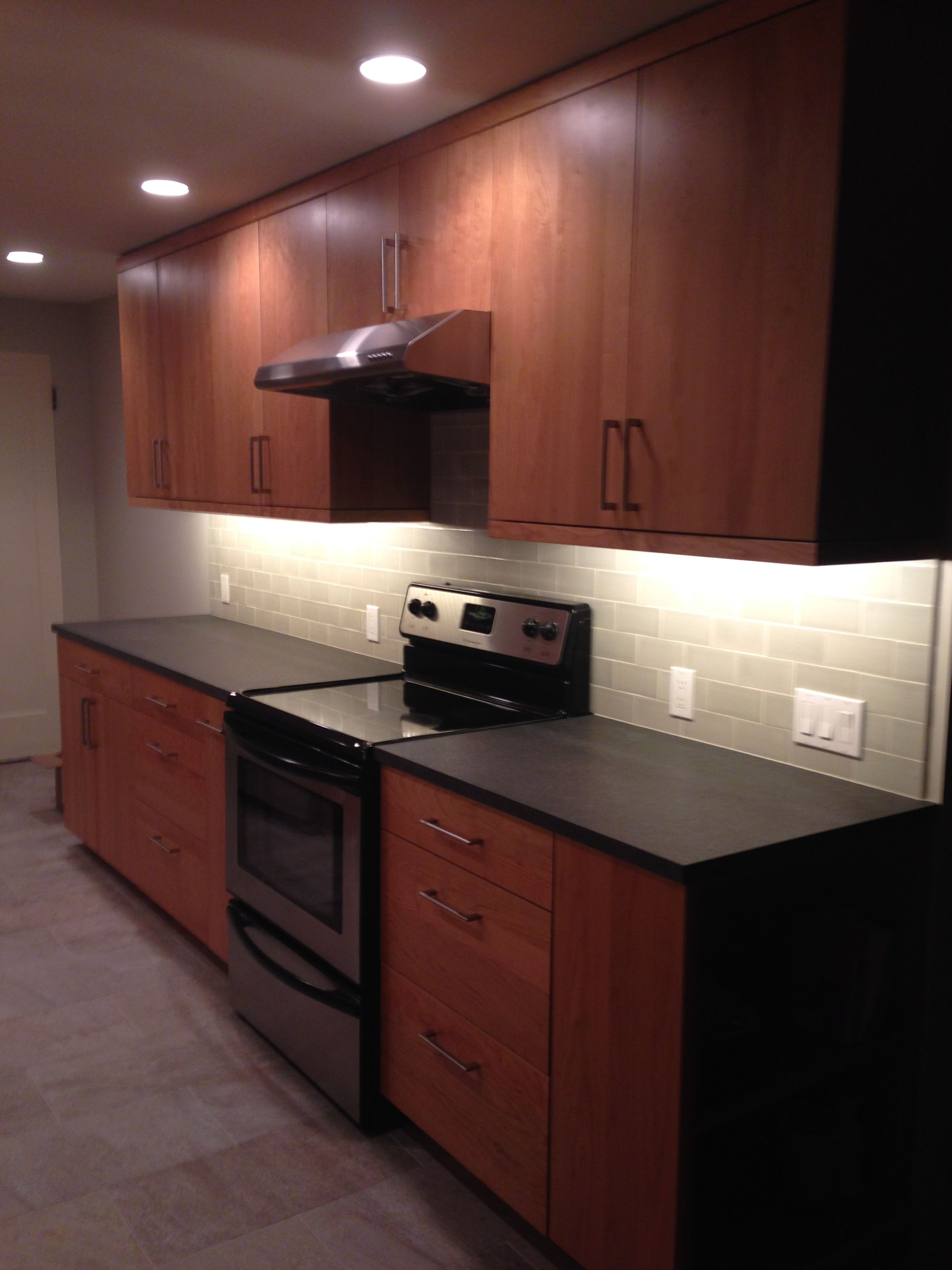 Fireclay Silver Haze Subway Backsplash, Absolute Black Anticado/leathered  Granite Counter, Pental Anthology Grey Floor Tile, DeWills Capella Cabinets  In ...