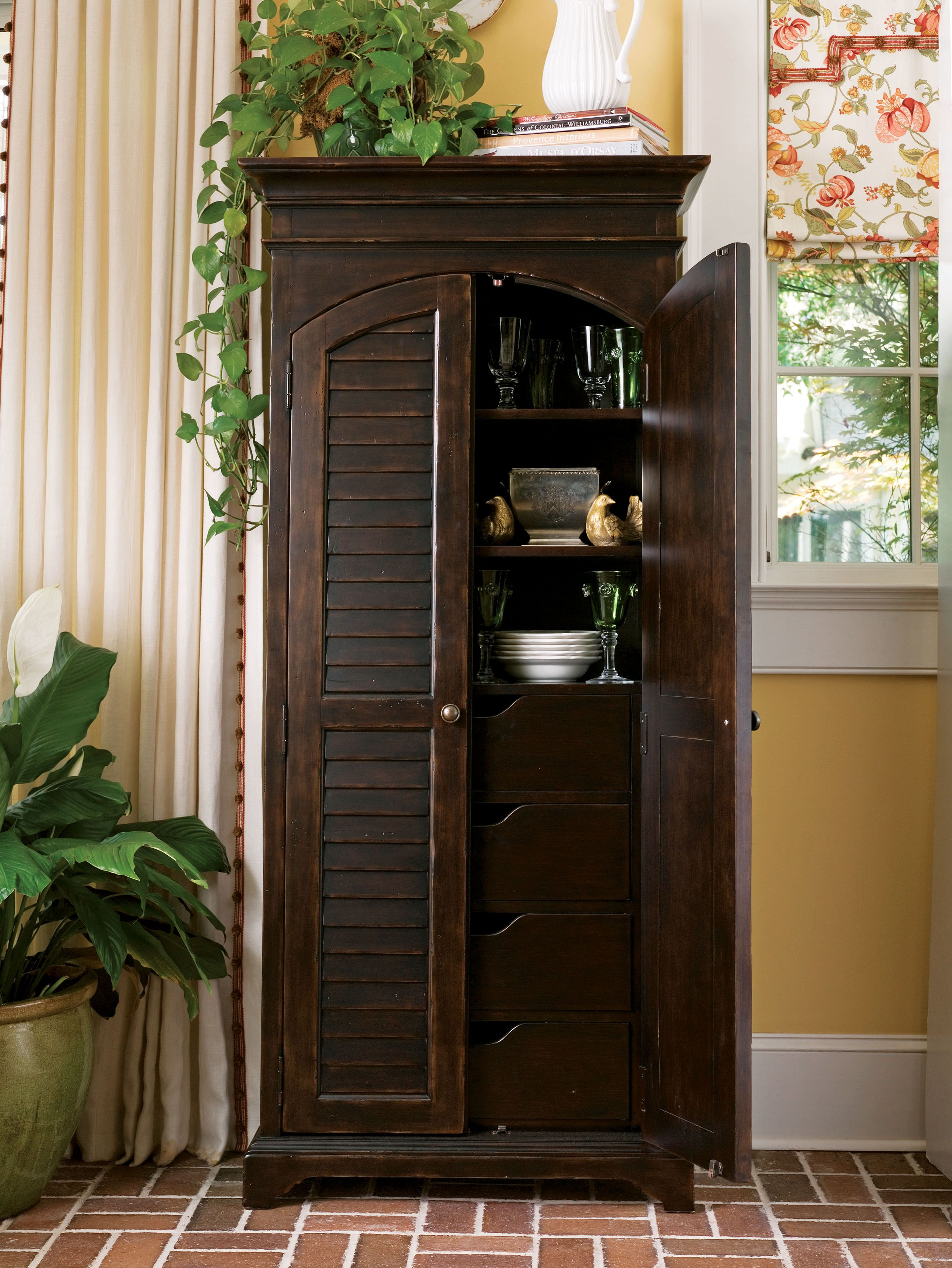 Superieur Paula Deen Home Collection  Utility Cabinet In A Tobacco Finish Is Perfect  For Hidden Storage