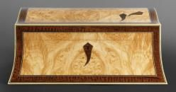 A double curved jewellery box veneered with burr maple