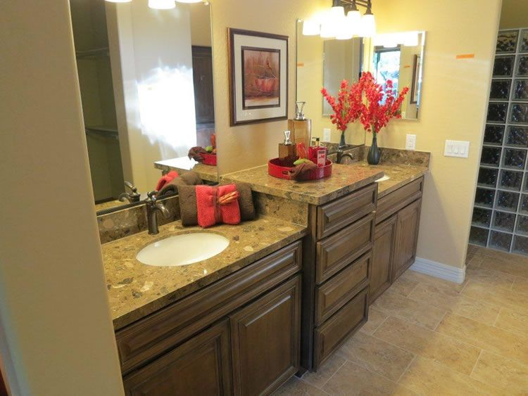 Double sinks in this mater bathroom provide extra room.  There will be no more working around anyone to get ready in the mornings!  The granite counter tops makes the room high end.  Pictured:  model 1850 Sunland Springs, Mesa AZ