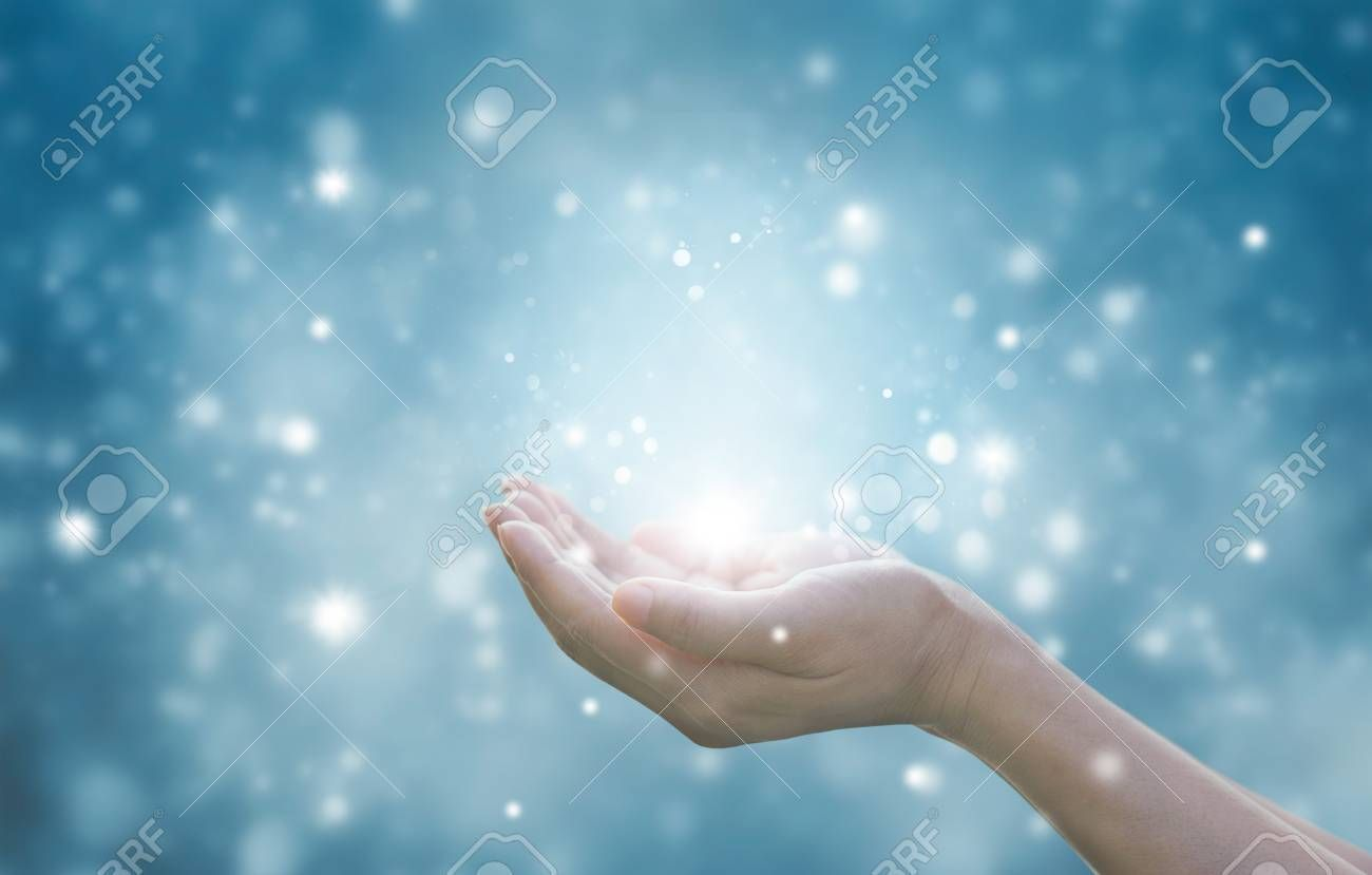 Hands of a woman respecting and praying on blue particle background