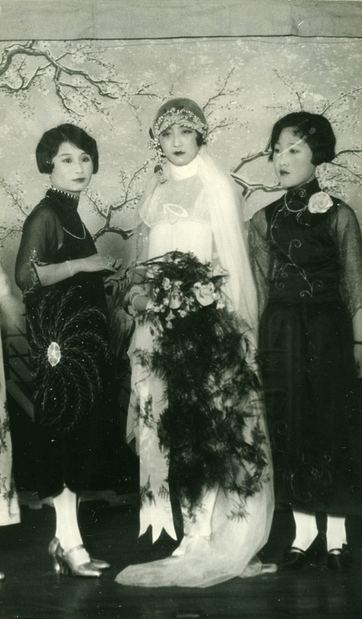 Mixing popular Western imported style with high neckline modified and flapper-looking Qipao dresses in chiffon! Chinese bride and bridesmaids, early 1920s, China.