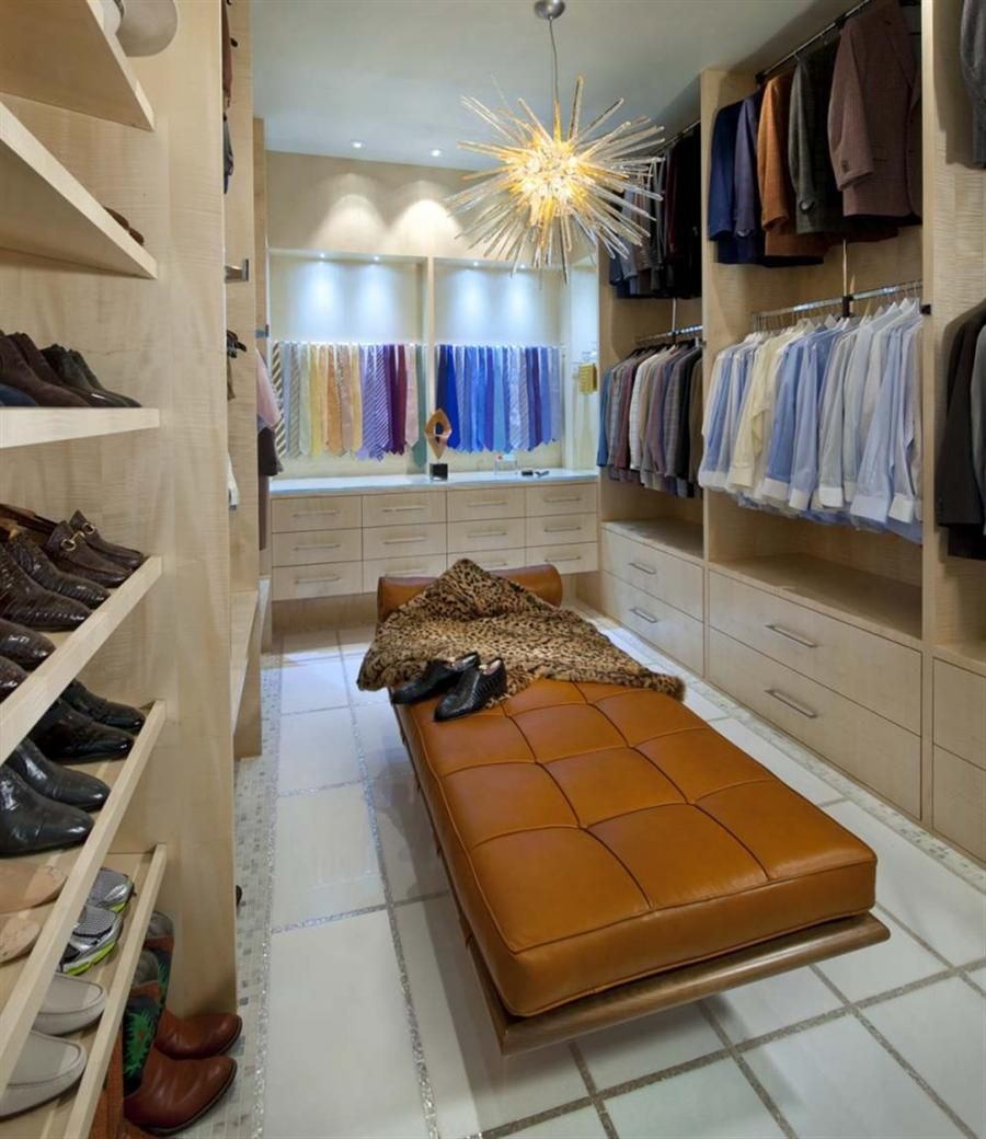 Modern closet design for men complemented by leather seat and a