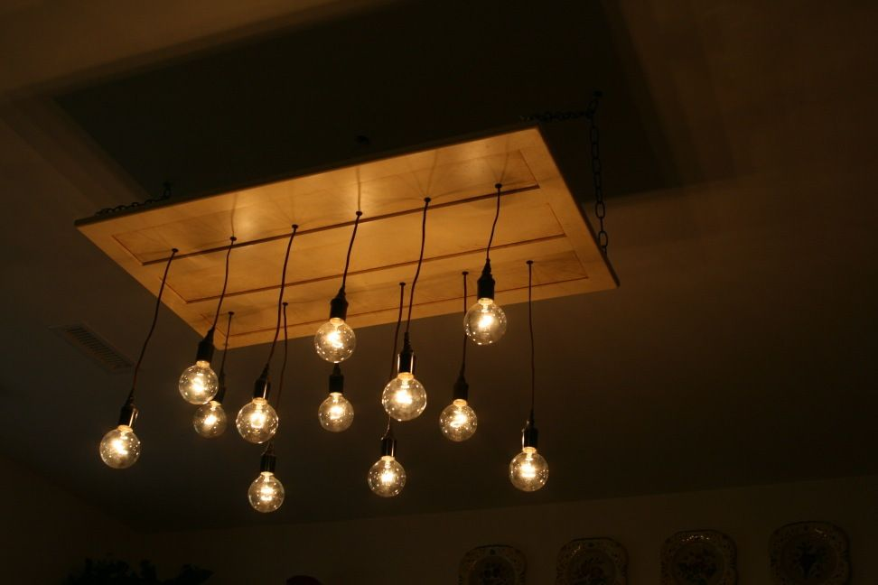 Build your own chandelier from an old cabinet door and some light build your own chandelier from an old cabinet door and some light sockets collin legault aloadofball Choice Image