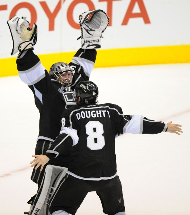 Drew Doughty 8 And Goaltender Jonathan Quick 32 Of The Los Angeles Kings Celebrate The Kings 6 1 Victory As Th La Kings Hockey Kings Hockey Los Angeles Kings