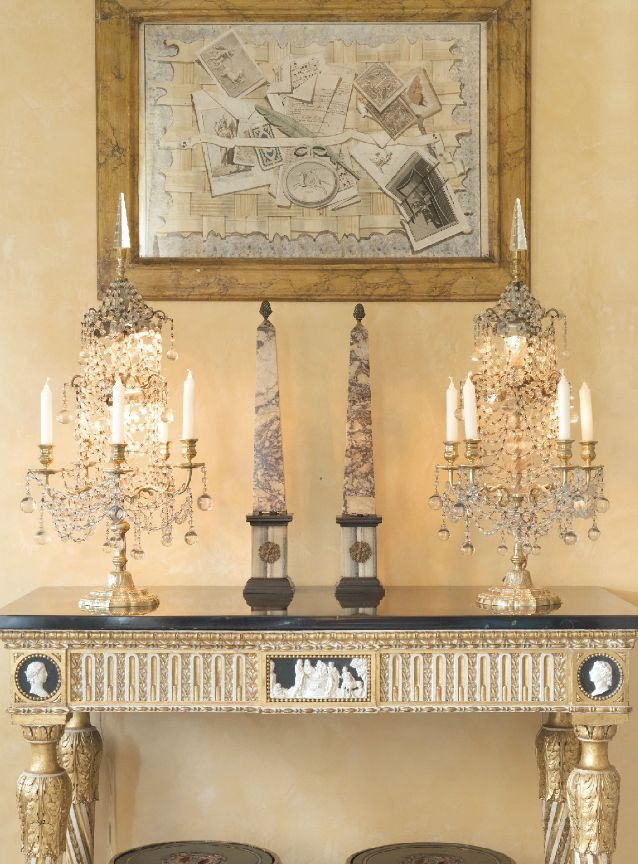 The two previously presented Obelisks, of red breccia marble, now beautifully displayed right in the middle of the composition ; on some slate tablet of an exceptional XVIII Century, gilded carved wood Console !... surounded by crystal chandeliers, under some fantastic painting...