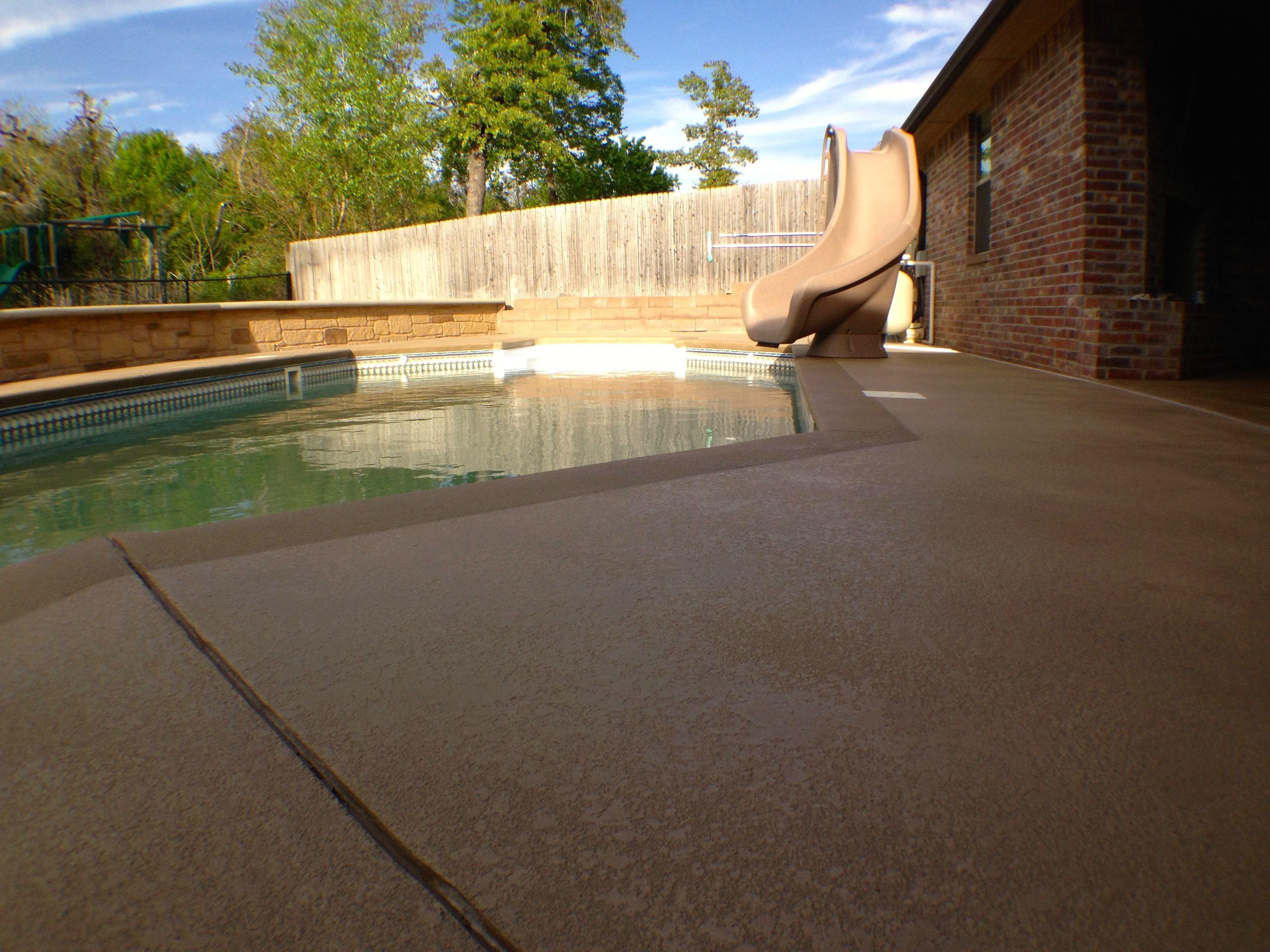 resurfaced concrete pool deck, spray down cool deck finish. buff