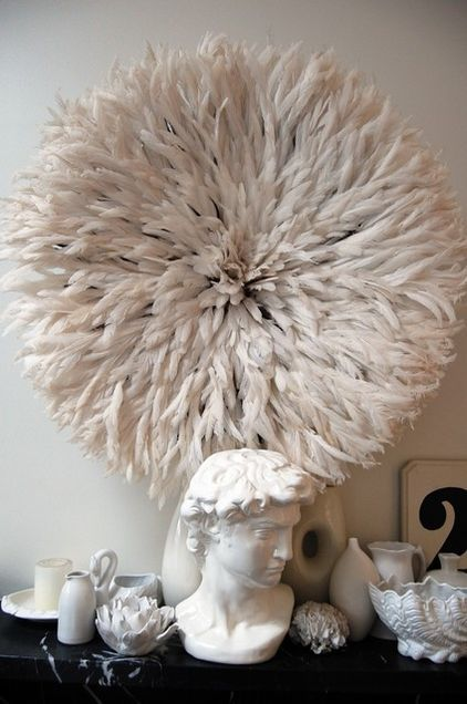 When choosing to decorate with white, texture is always a good choice. This Bamileke Feather Juju Hat is a sure way to add some drama to a space.