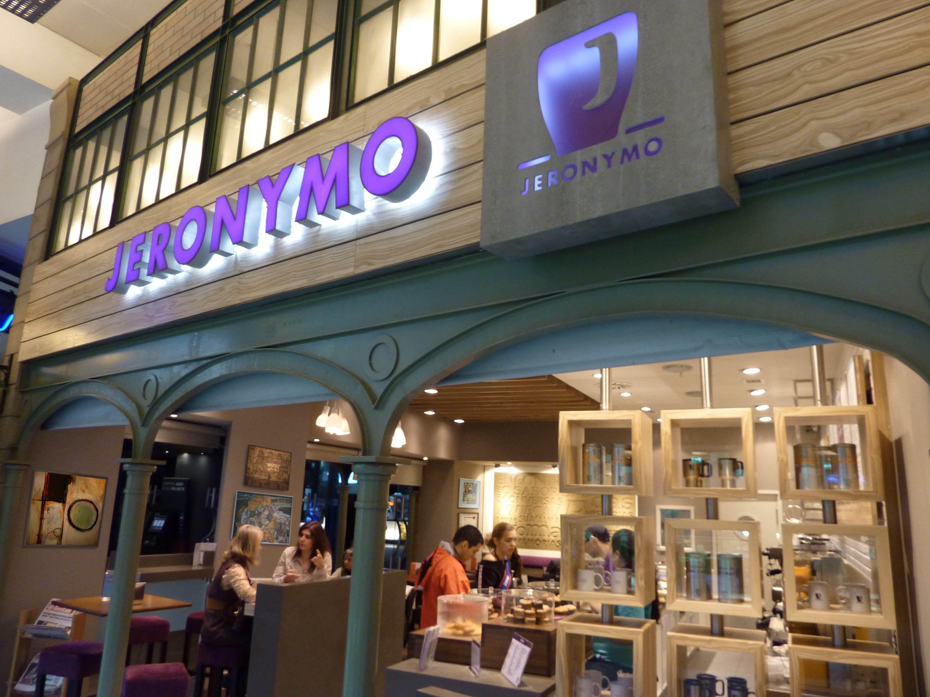 Jeronymo coffee store. Exterior branding. Lit purple