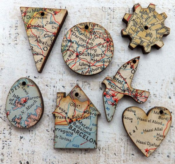 Little wood charms decoupaged with vintage maps - cute!.... try to find scrapbook paper with map and create ornaments of where we've visited - I love this idea!