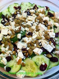 spinach salad with feta, cucumbers,pumpkin seeds and dried cranberries