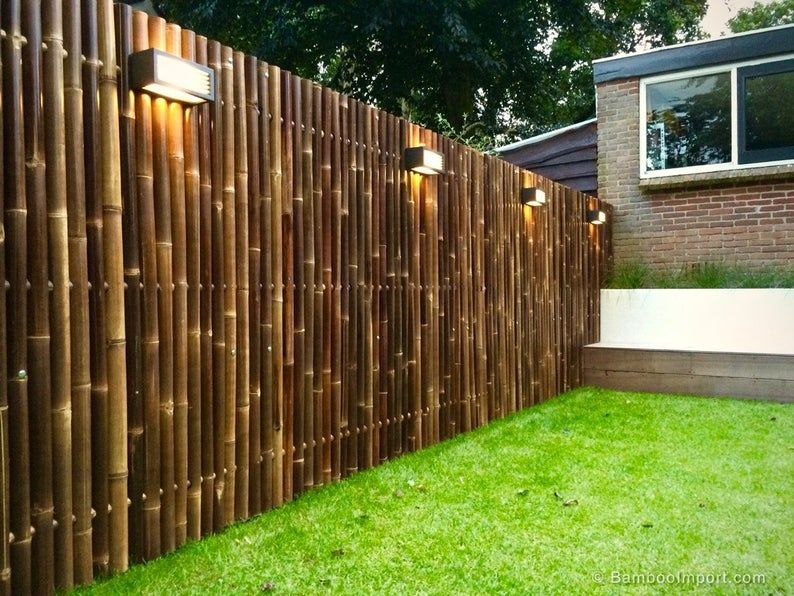 Photo of Natural Black Bamboo Fence Sold in 8 foot lengths- Choice of 4 Heights