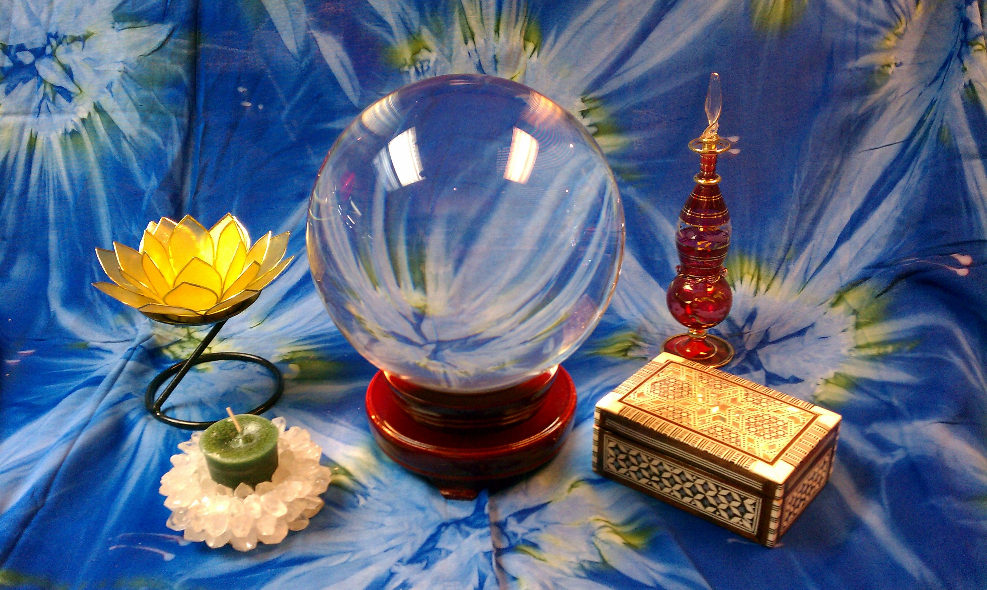 Clear crystal ball, capiz shell lotus t-lite holder, hand