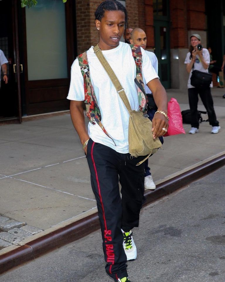 check out 69c69 e47a0 ASAP Rocky Seen In NYC Wearing S.P. Badu Track Pants And Dior Homme Sneakers