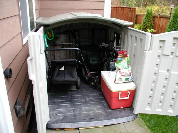 Lawn mower shed on pinterest lawn mower storage sheds for Garden shed for lawn mower