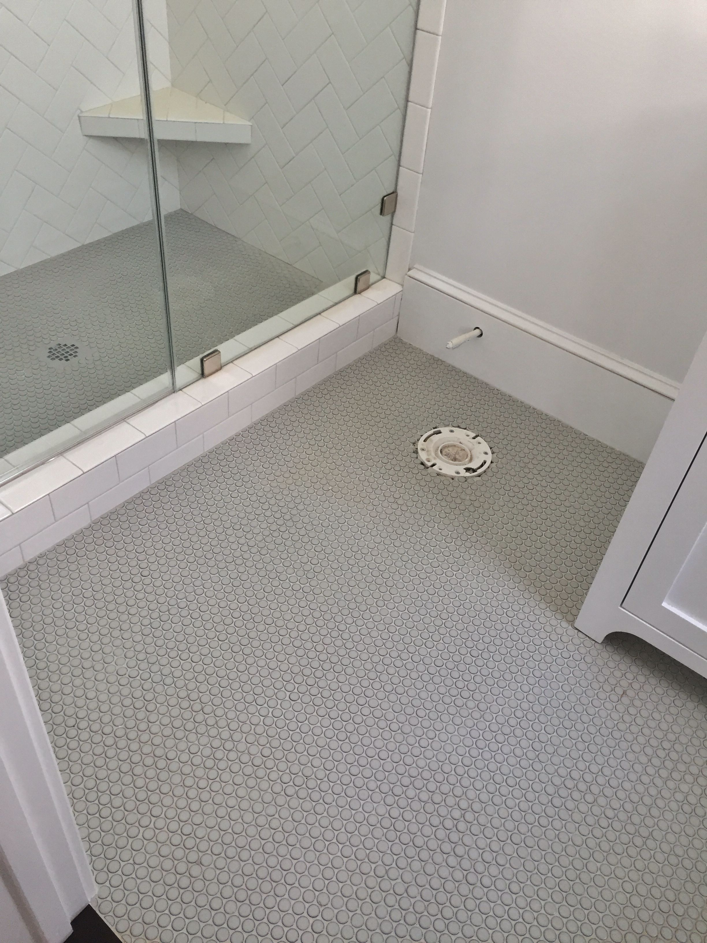 gray penny rounds on bathroom floor and shower floor 3x6 white subway tile set in