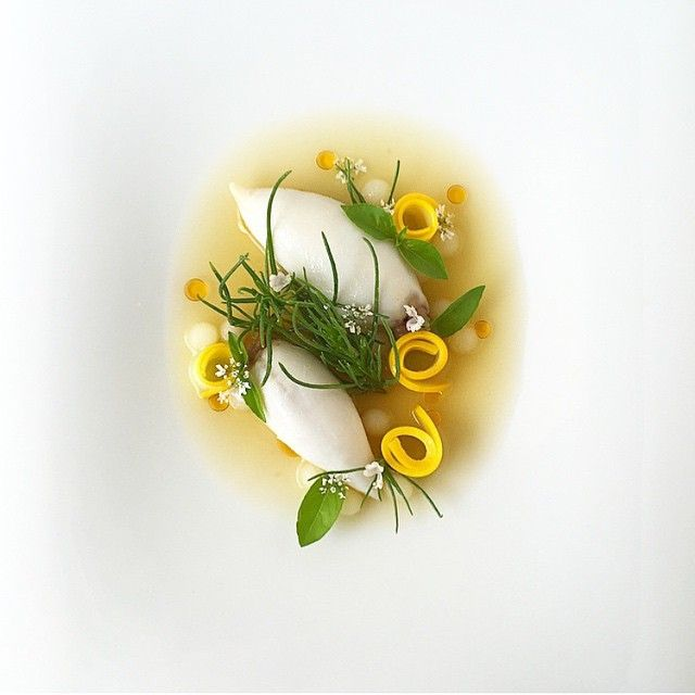 Butter poached North Atlantic squid stuffed with Arikara bean purée along with yellow zucchini ribbons, Agretti salad, and potato in a roasted spring garlic broth and chili oil by @adamseancron #TheArtOfPlating