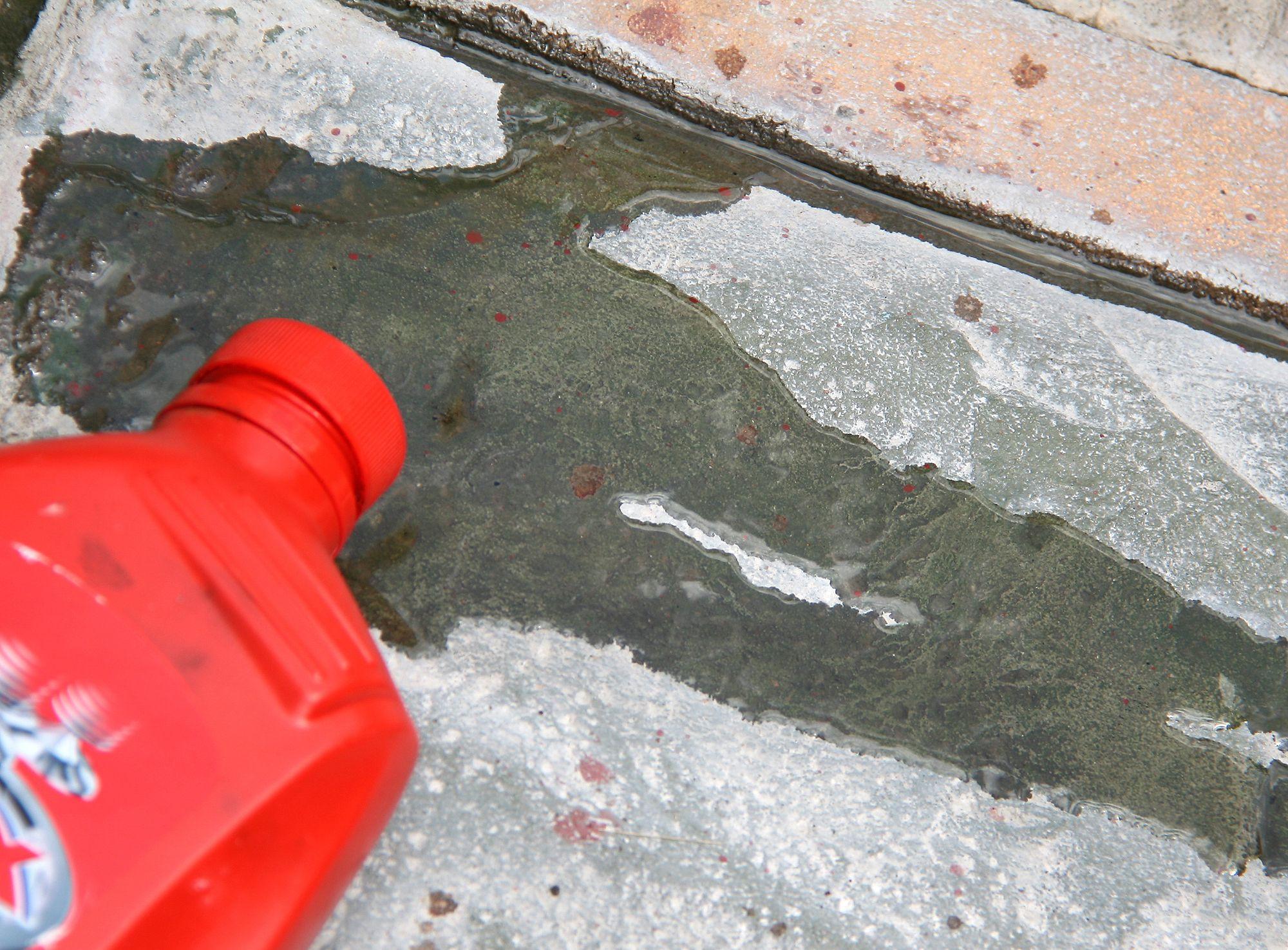 Remove motor oil from concrete driveway concrete for Motor oil stain removal from concrete