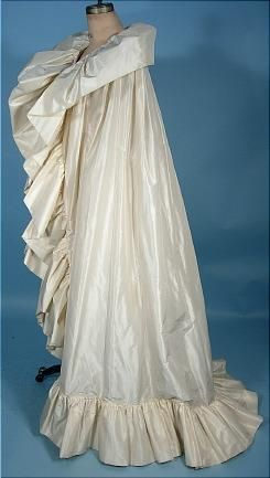 3b20ef763b78f For those  grand entrances  - designer Arnold Scaasi gives us an amazing  ivory silk taffeta opera cape. Floor length  giant ruffle that encircles  the entire ...