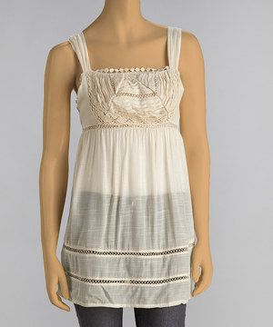 With its lovely lace and pretty peekaboo eyelets, this on-trend top exudes breezy boho elegance.