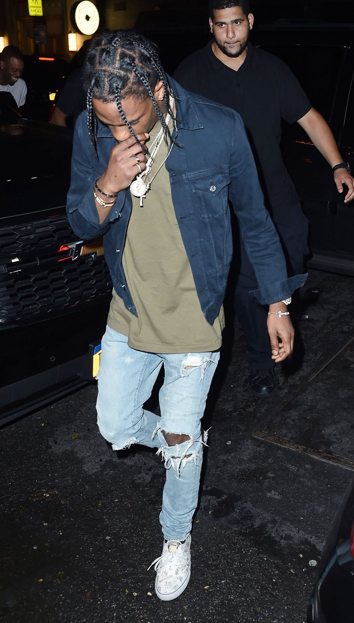 2f6ebd27fd09 Travis Scott looking fine, wearing a Denim Jacket Green T-shirt ripped Jeans  and White Sneakers