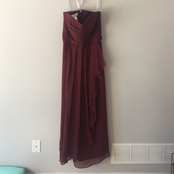 David's Bridal Bridesmaid Dress (wine) Size 12, how every I did some alteration to the dress in the chest area. I went up two dress sizes to it lay higher on me and not show Cleavage in all my sister wedding pics. very top of dress across chest 17 across, in the middle of the chest ruffle area 16 across, waist 16 across, length is 49. For the right braided maid this is an amazing deal dress was 300ish and my alterations were 89. I'm 5'4/5'5 but wore a 4 inch heel David's Bridal Dresses…
