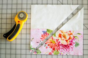Cut two five inch WOF, join, cut into squares, cut diagonally, rotate and join.