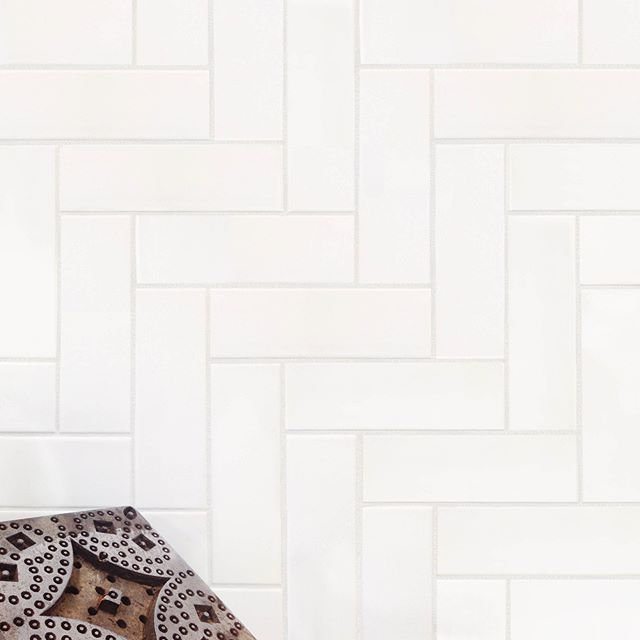 We Can T Get Enough Of White Subway Tile In A Stacked Herringbone