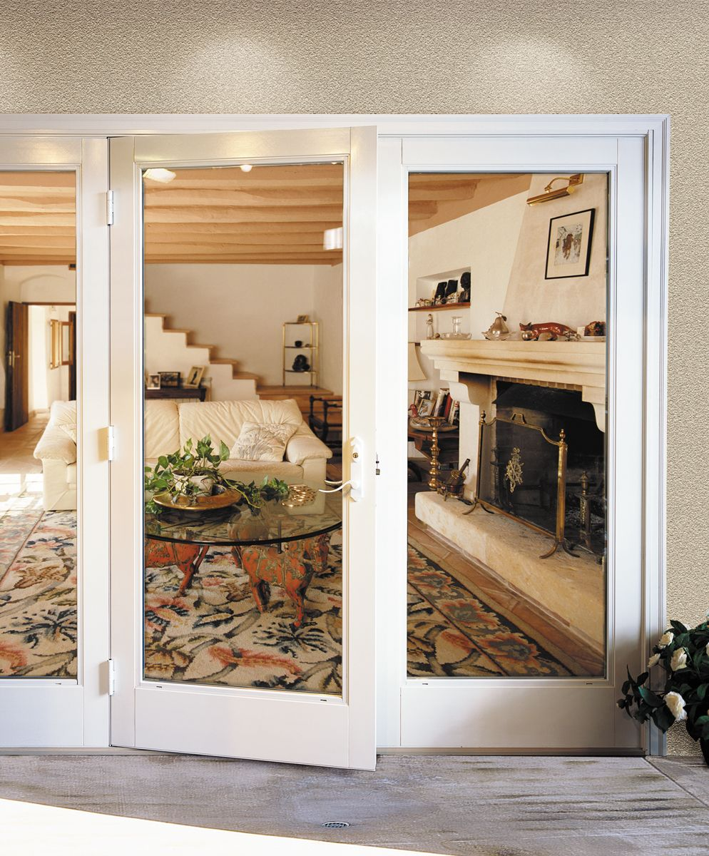 French doors open up this living room for expanded views - Exterior french doors that open out ...
