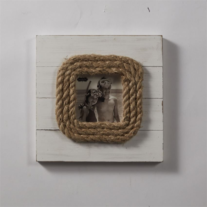 Distressed planked and painted wood frames feature thick jute rope ...