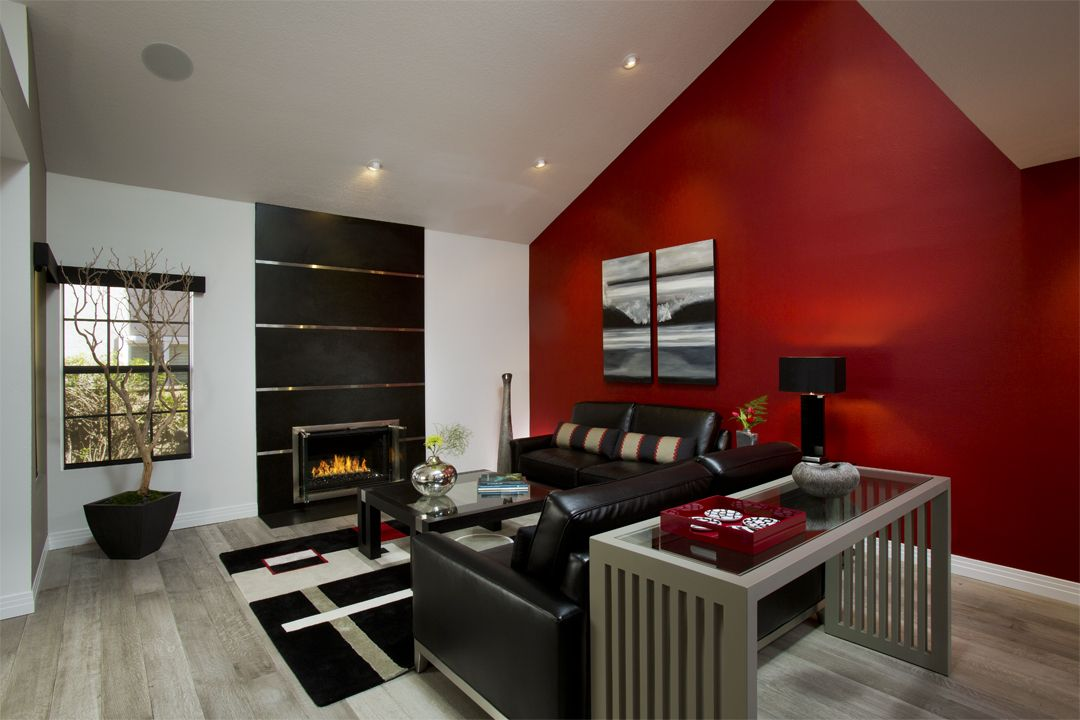 A Bright Red Accent Wall Draws You In As You Walk Into The