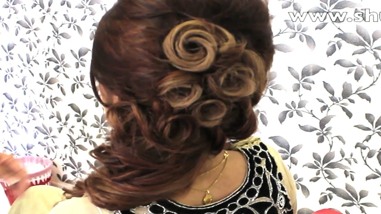 indian bridal hairstyles - side twist hairdo for a mehndi