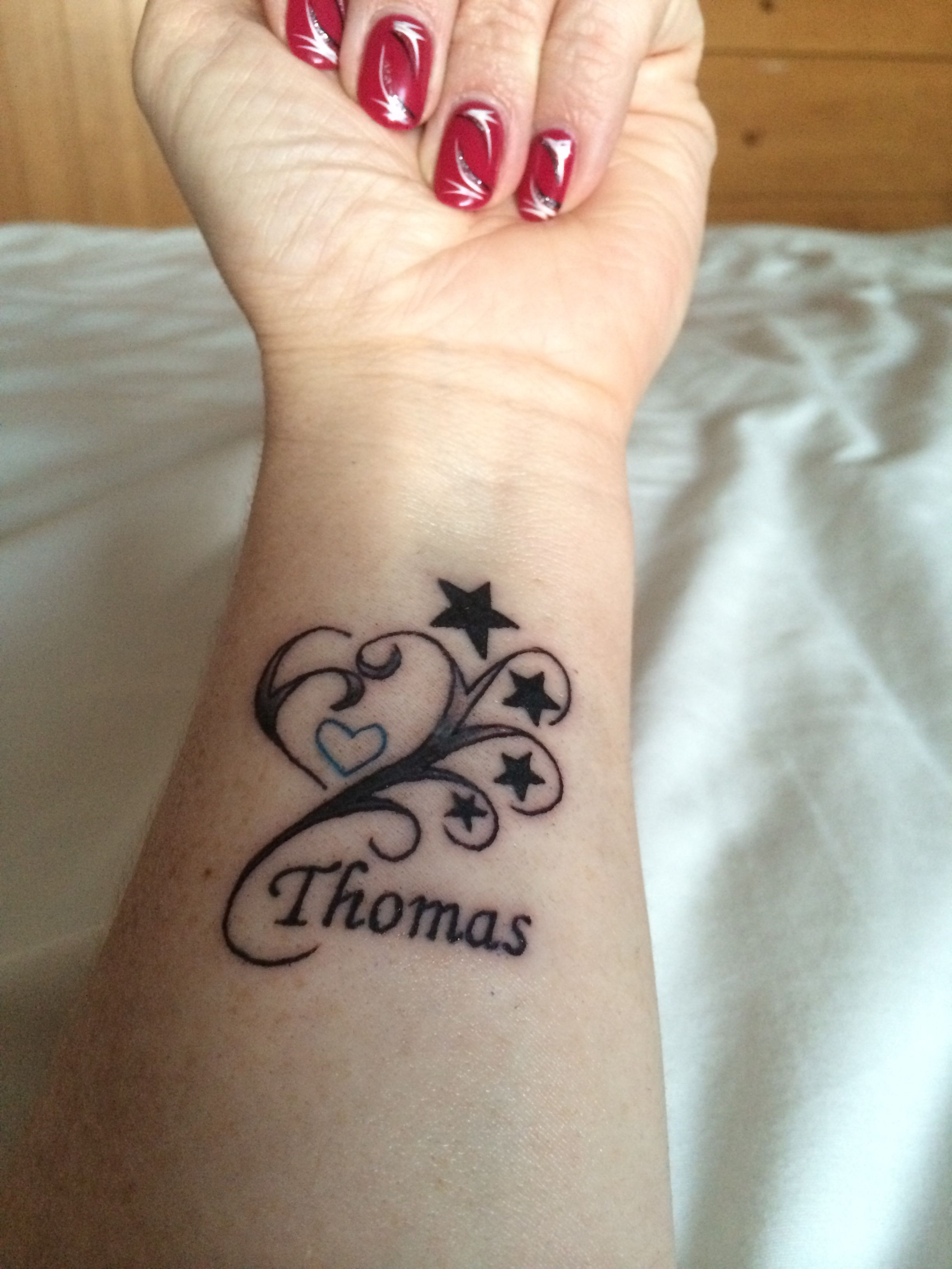 My new wrist/arm tattoo done for my son Thomas. A blue