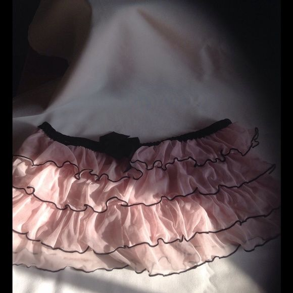 Fun Ruffled skirt Light sheer tiny skirt. It has a built-in thong. Not used but bought here. Could fit XS! PlayBoy Skirts Mini