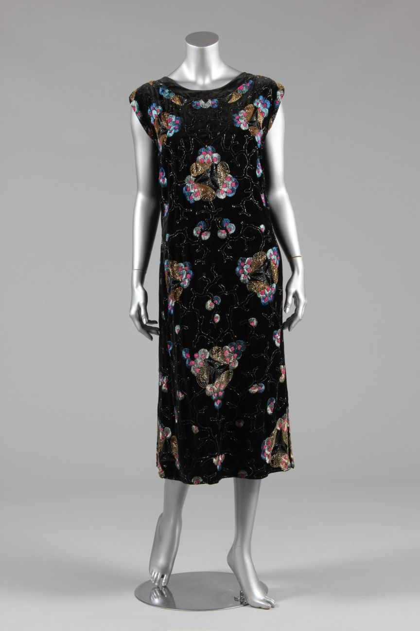 An embroidered and beaded black velvet dress circa us