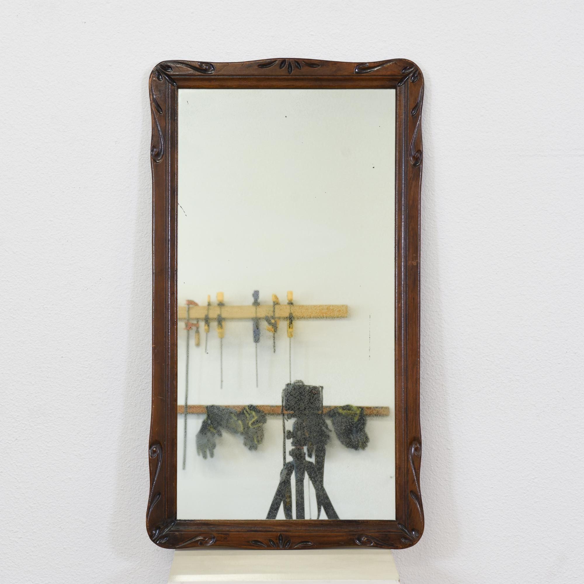 This Antique Mirror Is Featured In A Solid Wood With A Glossy Dark