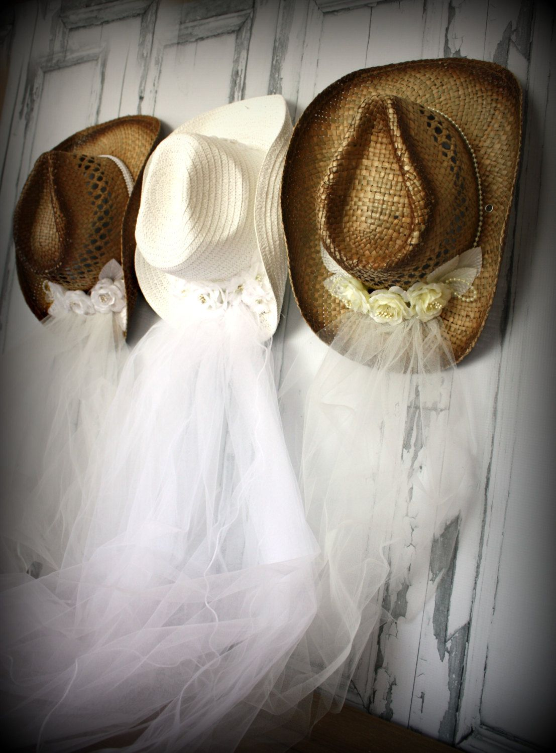 0d44fb152e7 I would love for all the bridesmaids to wear brown cowgirl boots and the  bride to wear a white one with a veil. ( . Western wedding Cowgirl hat ...