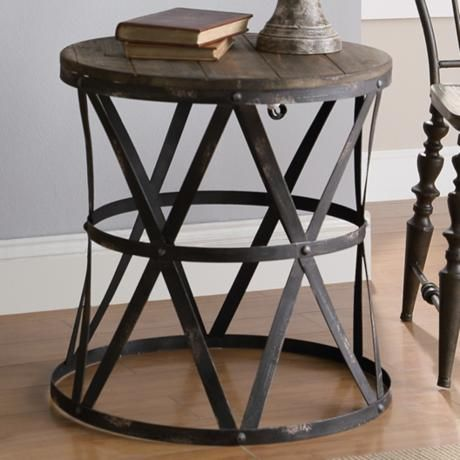 Casual Wood Top Round Accent Table Features An Industrial Metal Webbed Base  $223.91