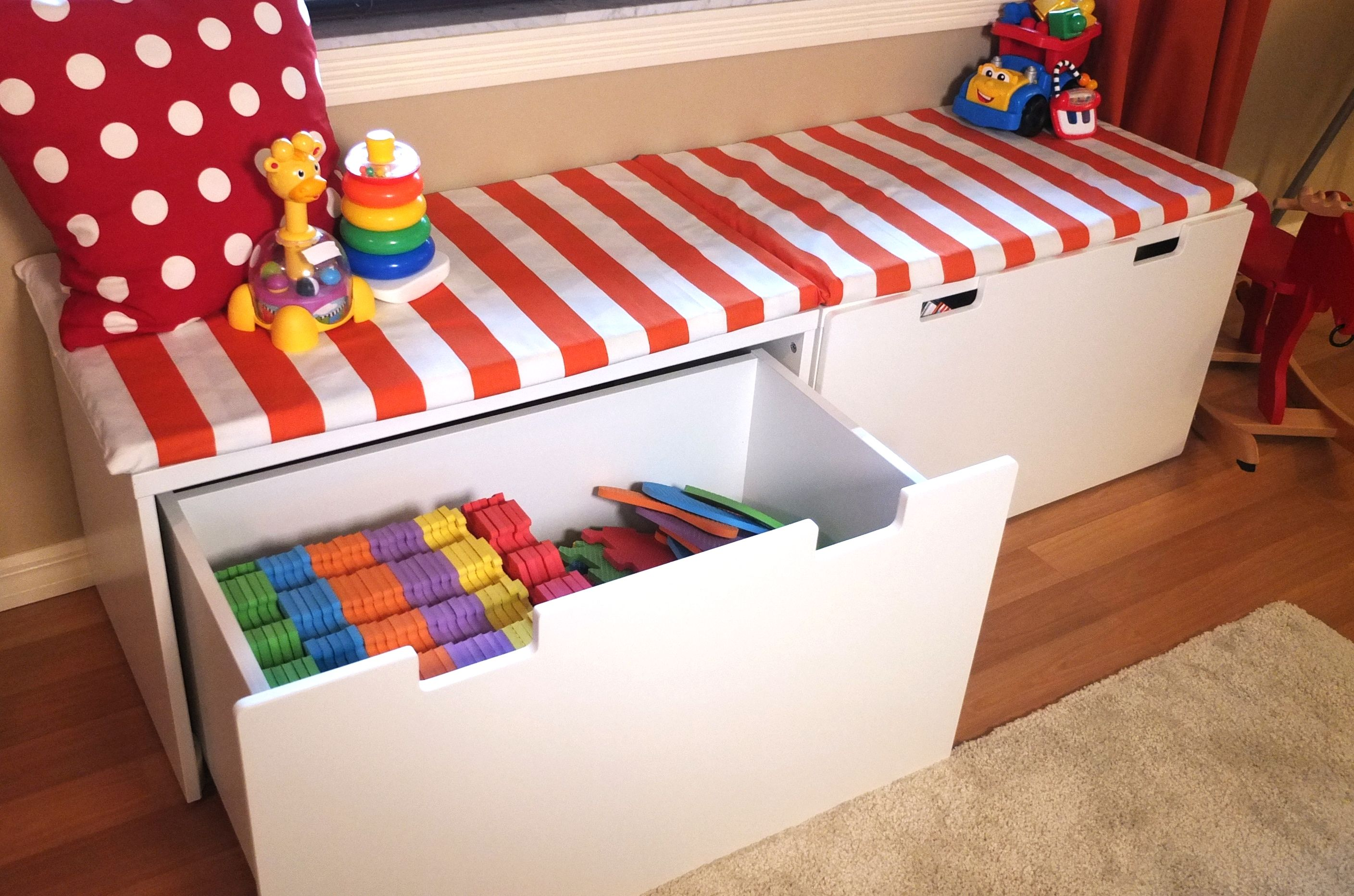 The stuva storage bench provides a comfortable window seat for Kids room toy storage