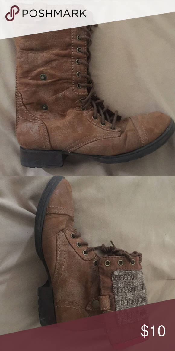 Brown combat boots They are brown with a red detailed zipper and they fold down to expose a brown, tweedy type material. Route 66 Shoes Combat & Moto Boots