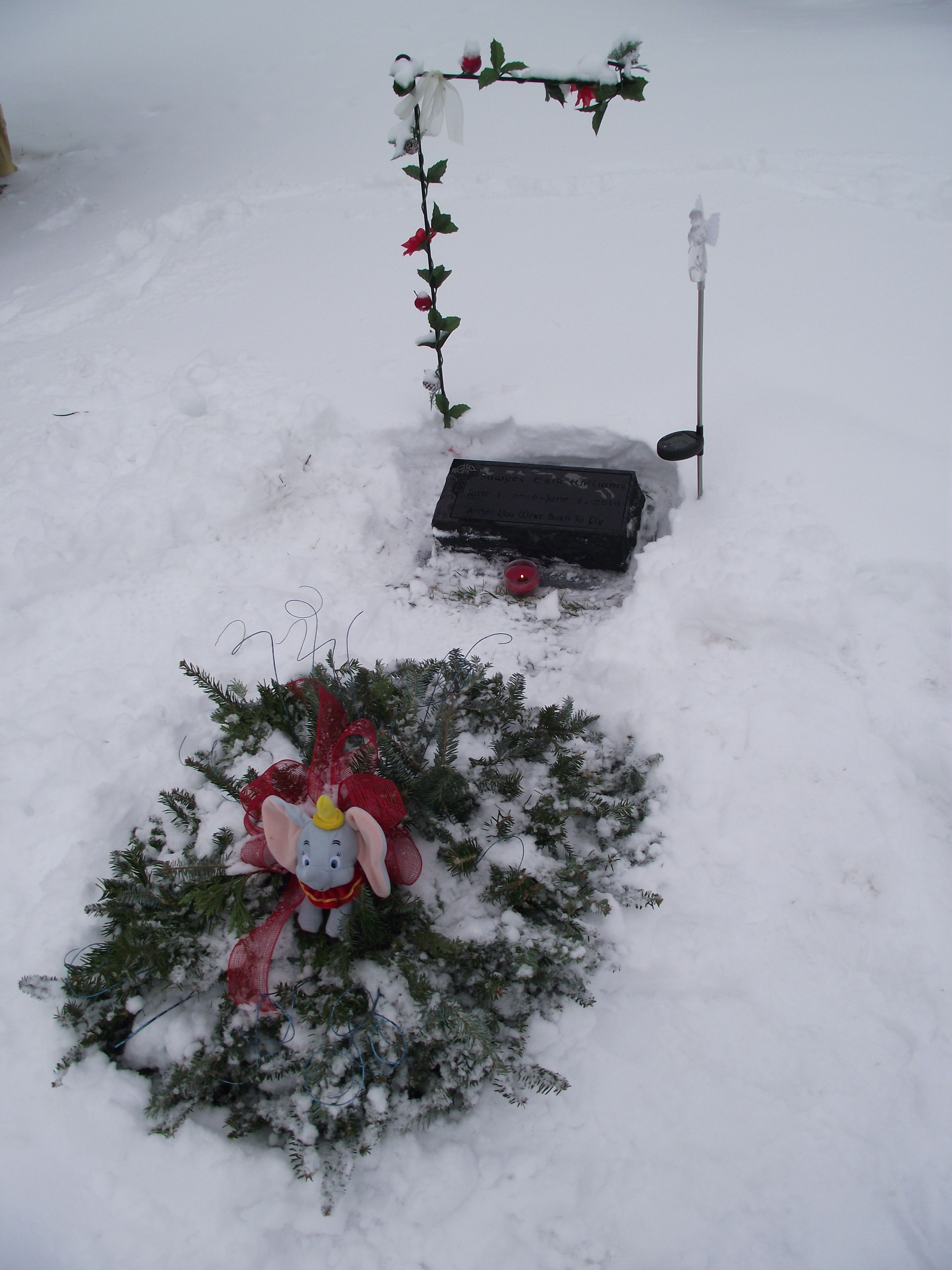 very simple way to decorate a grave during winter months use